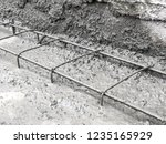 builders pour concrete into the ...   Shutterstock . vector #1235165929