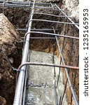 builders pour concrete into the ...   Shutterstock . vector #1235165953