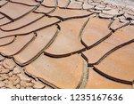 big mud cud cracks and dried... | Shutterstock . vector #1235167636