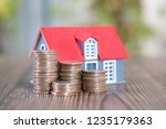 small house model and dollar... | Shutterstock . vector #1235179363