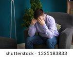 man suffering from headache at... | Shutterstock . vector #1235183833