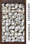 gabion with white stones | Shutterstock . vector #1235191303