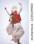 sikh men dancing  | Shutterstock . vector #1235239003