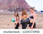 three women friends walk...   Shutterstock . vector #1235272900