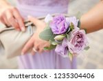 woman with violet bracelet of... | Shutterstock . vector #1235304406