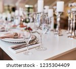 wedding table serivce. candles... | Shutterstock . vector #1235304409