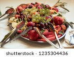 dinner table service. dish with ... | Shutterstock . vector #1235304436