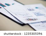 business documents with charts... | Shutterstock . vector #1235305396