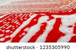 orange car surface with foam... | Shutterstock . vector #1235305990