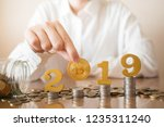 2019 new digital money. female... | Shutterstock . vector #1235311240
