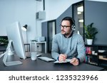 tech manager with headset... | Shutterstock . vector #1235323966