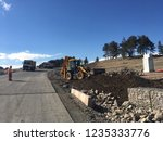 backhoe loader moves fill... | Shutterstock . vector #1235333776