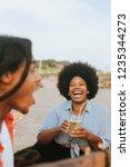 friends having fun at a picnic | Shutterstock . vector #1235344273