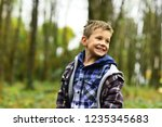 playful and lively. playful boy.... | Shutterstock . vector #1235345683
