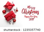 merry christmas and happy... | Shutterstock . vector #1235357740