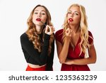 portrait of two pretty young... | Shutterstock . vector #1235363239