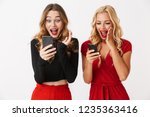 portrait of two excited young... | Shutterstock . vector #1235363416