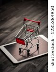 close up of shopping trolley on ... | Shutterstock . vector #1235384950