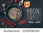 top view of frying pan with...   Shutterstock . vector #1235430169