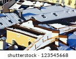 houses covered with snow at... | Shutterstock . vector #123545668