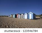 beach huts against a blue sky...
