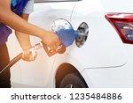 close up hand of a man pumping... | Shutterstock . vector #1235484886