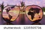 sunglasses on a dark surface... | Shutterstock . vector #1235505736
