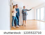 realtor showing house to a... | Shutterstock . vector #1235522710
