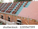 a new roof is installed in the...   Shutterstock . vector #1235567599