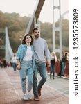 stylish couple in love hugging... | Shutterstock . vector #1235573809