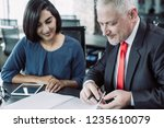 content coach reviewing notes...   Shutterstock . vector #1235610079