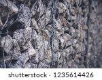 gabion protective wall | Shutterstock . vector #1235614426