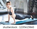 fitness asian woman doing yoga... | Shutterstock . vector #1235615860