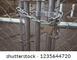 locked gate boarder tethered by ... | Shutterstock . vector #1235644720