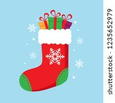 christmas sock in red color... | Shutterstock .eps vector #1235652979