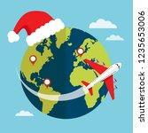 travel by airplane in christmas ... | Shutterstock .eps vector #1235653006