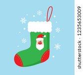 christmas sock in green color... | Shutterstock .eps vector #1235653009