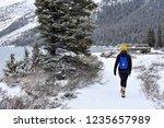 active woman walking along... | Shutterstock . vector #1235657989