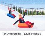 mix race women sledding on snow ... | Shutterstock .eps vector #1235690593