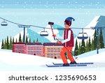 man taking selfie ski resort... | Shutterstock .eps vector #1235690653