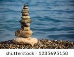 symbolic scales of stones... | Shutterstock . vector #1235695150