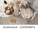 warm knitted sweater on... | Shutterstock . vector #1235698876