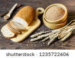 wheat bran and flour bread with ... | Shutterstock . vector #1235722606