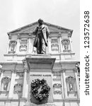 Small photo of Statue of writer Alessandro Manzoni in front of San Fedele church, Milan, Italy