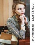 young beautiful lady wearing... | Shutterstock . vector #1235757670