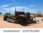 wrecked cars lie abandoned in... | Shutterstock . vector #1235761360