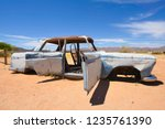wrecked cars lie abandoned in... | Shutterstock . vector #1235761390