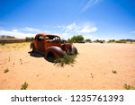 wrecked cars lie abandoned in... | Shutterstock . vector #1235761393