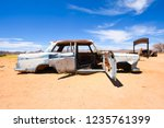 wrecked cars lie abandoned in... | Shutterstock . vector #1235761399