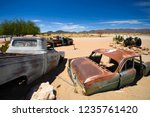wrecked cars lie abandoned in... | Shutterstock . vector #1235761420